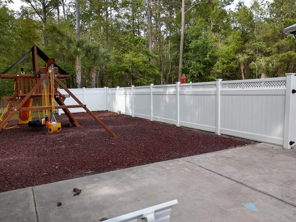 jungle gym and white fence